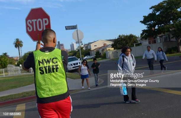 Crossing guard helps students and parents on their way to New West Charter School on the corner of Missouri and Armacost Avenues in West Los Angeles...