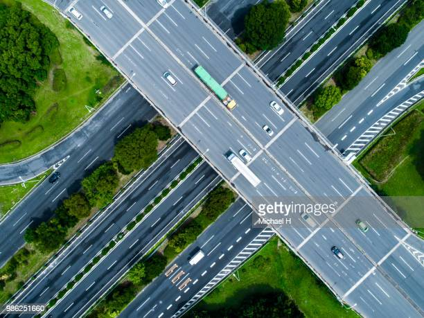 a crossing highway. scenery of the town with trees. - ドローン撮影 ストックフォトと画像