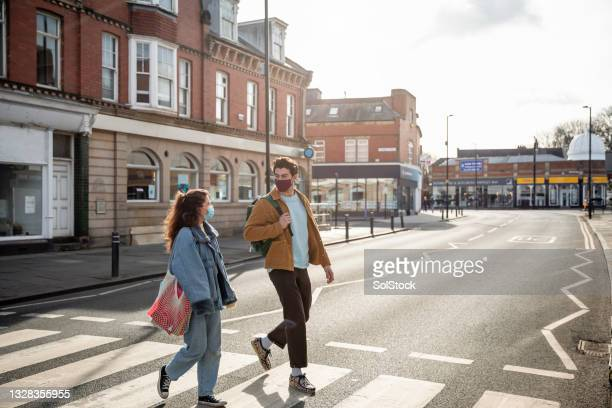 crossing in the town centre - flatten the curve stock pictures, royalty-free photos & images
