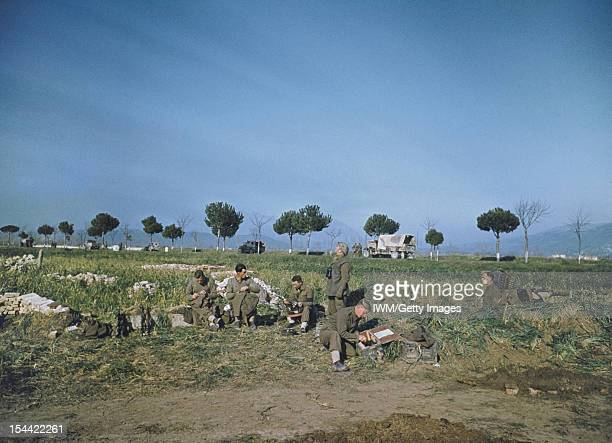 Crossing Of The Garigliano River By The Fifth Army Italy 19 January 1944 A crew of a Bofors gun in the Garigliano area doing some sewing Transport on...