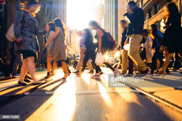 crossing people - traffic at rush hour - motion blur stock photos and pictures