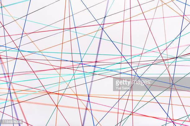 crossing rainbow  color strings - string stock pictures, royalty-free photos & images