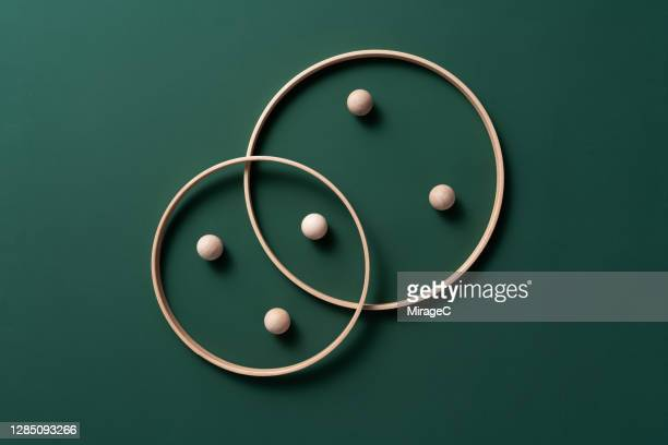 crossing rings with spheres - organised group stock pictures, royalty-free photos & images