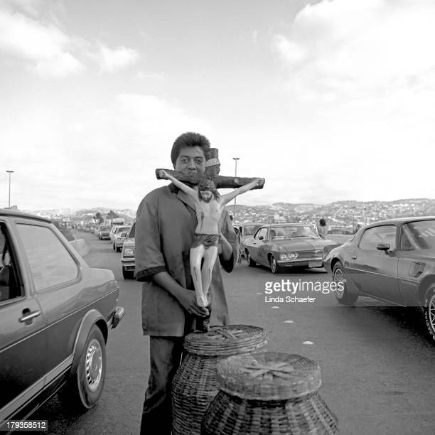 Crossing the border from Tijuana to San Diego in 1988 during the presidential campaign. Vendors easily visible selling oversized crucifixes and other...