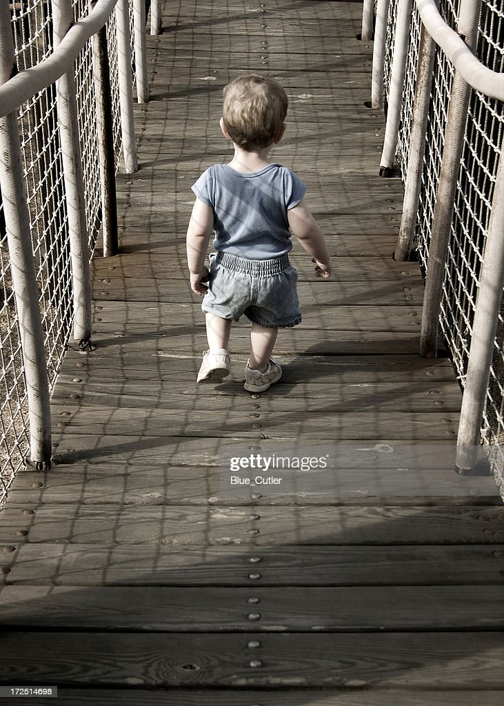 Crossing the bridge : Stock Photo