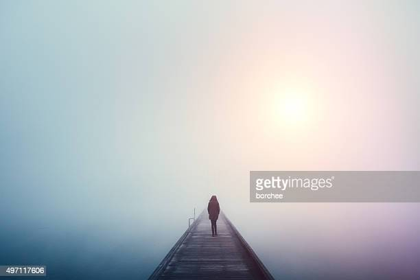 crossing the bridge - loneliness stock pictures, royalty-free photos & images
