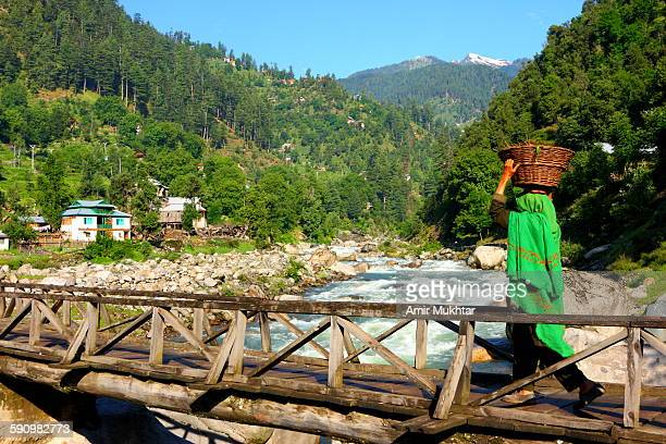 crossing the bridge - kashmir valley stock pictures, royalty-free photos & images