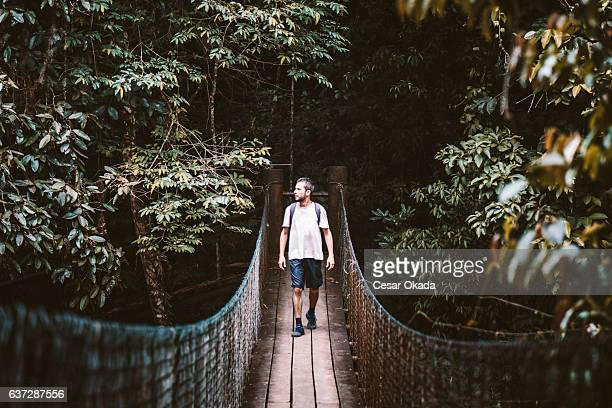 crossing the bridge - brazilian men stock photos and pictures
