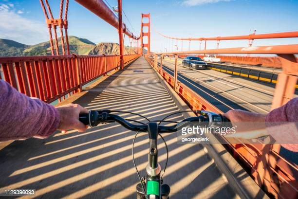 crossing the golden gate bridge by bike - golden gate bridge stock pictures, royalty-free photos & images