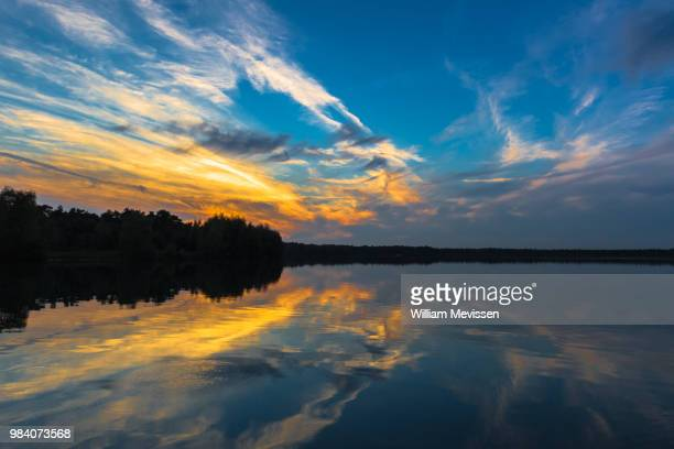 crossing the lake - william mevissen stock pictures, royalty-free photos & images