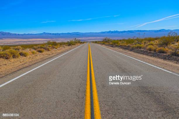 crossing the mojave - two lane highway stock pictures, royalty-free photos & images