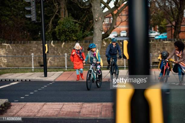 crossing the road - road stock pictures, royalty-free photos & images