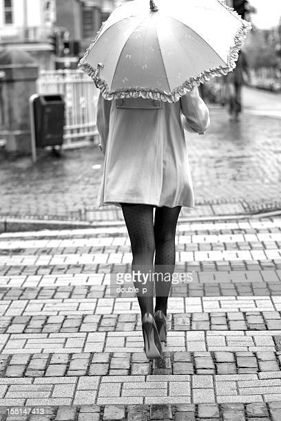crossing the road - high heels short skirts stock photos and pictures