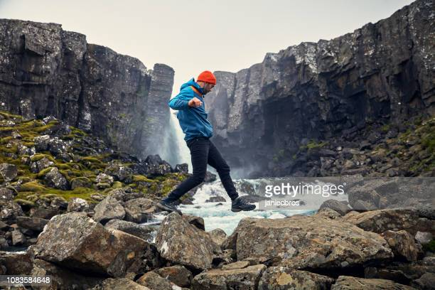 crossing the stream. mountain landscape - hiking boot stock pictures, royalty-free photos & images