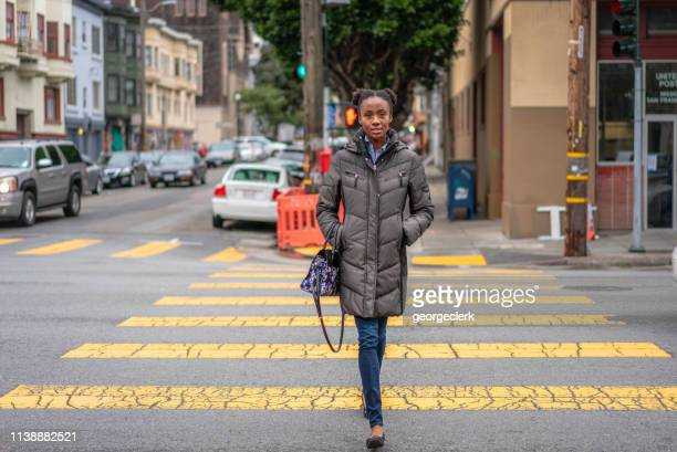 crossing the street in san francisco's mission district - approaching stock pictures, royalty-free photos & images