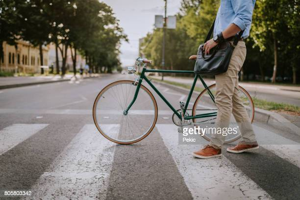 crossing the street with the bicycle - zebra crossing stock photos and pictures