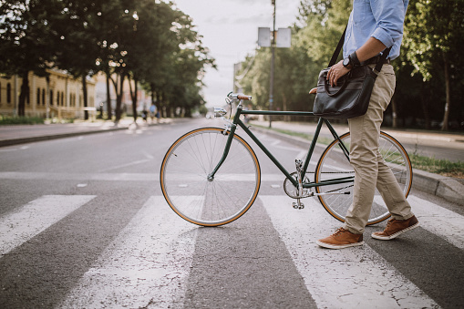 Crossing the Street with the bicycle 932463446