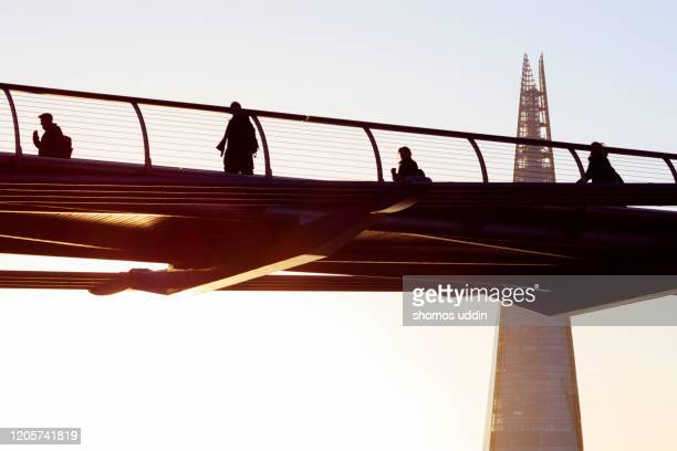 crossing the thames at sunrise - architecture stock pictures, royalty-free photos & images