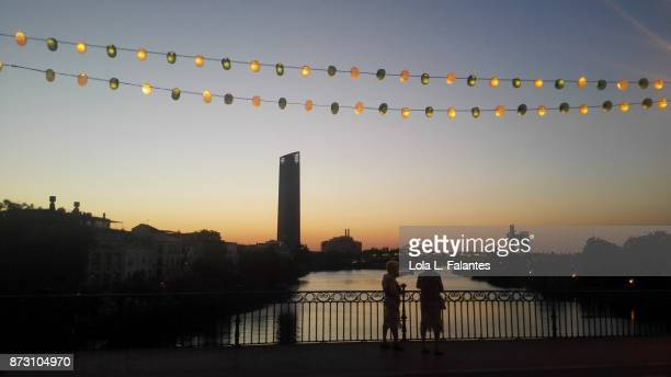 Crossing Triana bridge at sunset. Seville