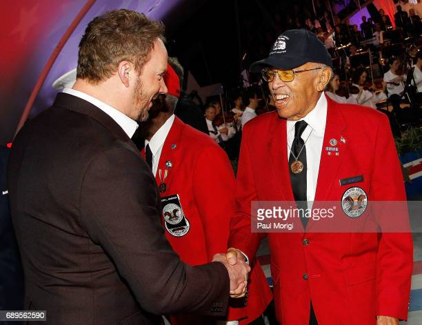 Crossover artist Russell Watson shakes hands with a member of The Tuskegee Airmen onstage at the show finale of PBS' 2017 National Memorial Day...
