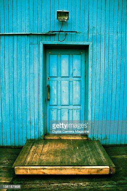 Crossprocessed image of a bright blue wall and door taken on July 26 2009