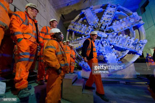 Crossrail construction workers stand near to one of the 1,000 tonne tunnel boring machines during a photocall to mark the breakthrough into the...