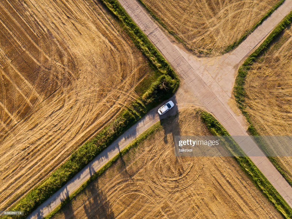 Crossroad between grainfields from above, Germany : Stock Photo