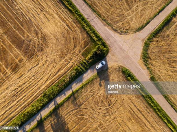 Crossroad between grainfields from above, Germany