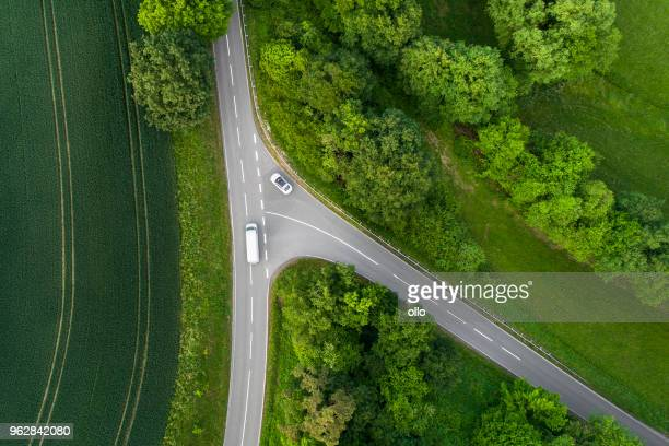 crossroads, country road - aerial view - crossroad stock pictures, royalty-free photos & images
