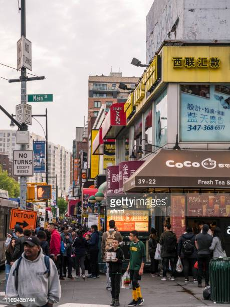 crossroads in flushing, queens, new york city - flushing queens stock pictures, royalty-free photos & images