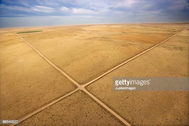 Crossroads through deserted landscape