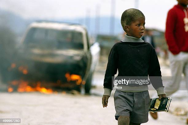 1985 Crossroads Township Cape Town South Africa A young boy wanders through the streets of the Crossroads Township in South Africa He is clutching a...