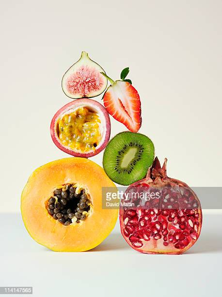 A cross-section of fruits with lots of seeds