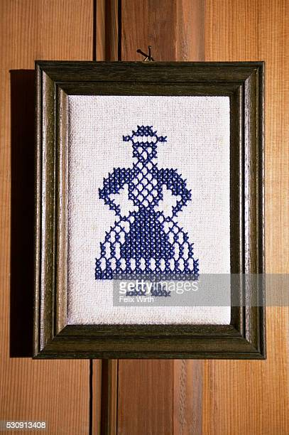 Cross-stitch of woman