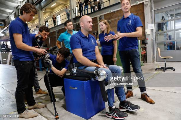 Crossstroke patient Ruben de Sain sets the first steps in the exoskeleton of the Technical University Delft in Delft on August 31 2017 The supporting...