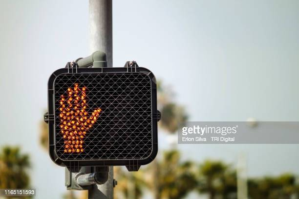 crosswalk sign in stop mode - walk don't walk signal stock pictures, royalty-free photos & images