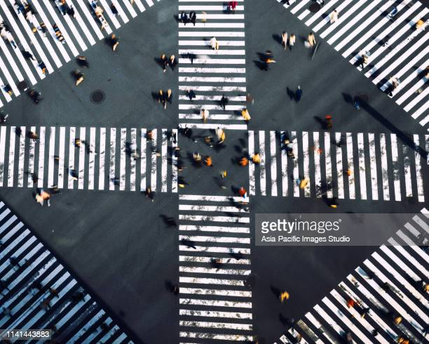 crosswalks  in ginza, tokyo-japan - overhead view of traffic on city street tokyo japan stock photos and pictures