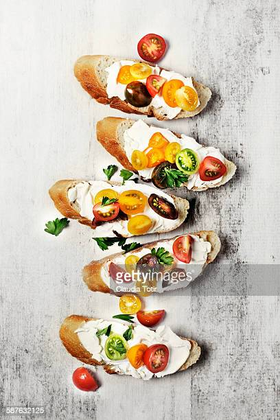 crostini with fresh tomatoes - appetizer stock pictures, royalty-free photos & images