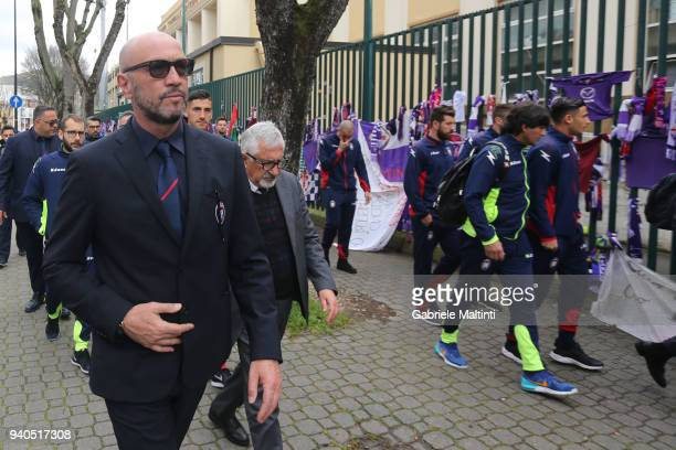 Crotone manager Walter Zenga arrives with players after remembering former captain Davide Astori of ACF Fiorentina by leaving a bunch of flowers and...