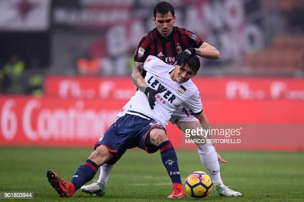 Crotone's Croatian forward Ante Budimir vies with AC Milan's defender Alessio Romagnoli during the Italian Serie A football match AC Milan Vs Crotone...