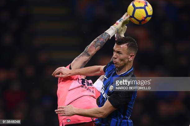 Crotone's goalkeeper Alex Cordaz fights for the ball with Inter Milan's forward Ivan Perisic from Croatia during the Italian Serie A football match...