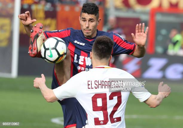 Crotone's Italian defender Davide Faraoni fights for the ball with Roma's Italian striker Stephan El Shaarawy during the Italian Serie A football...