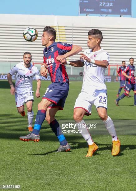 STADIUM CROTONE CALABRIA ITALY Crotone's Italian forward Andrea Nalini fights for the ball with Bologna's Italian defender Adam Masina during the...