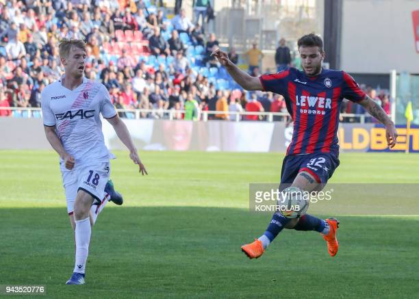 Crotone's Italian forward Marco Tumminiello controls the ball next to Bologna's Swedish defender Filip Helander during the Italian Serie A football...