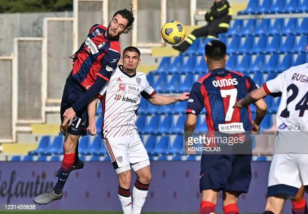 Crotone's italian midfielder Niccolo Zanellato jump for the ball with Cagliari's romanian midfielder Razvan Marin during the Italian Serie A football...