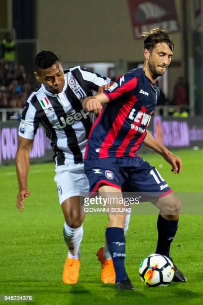 Crotone's midfielder Andrea Barberis holds off Juventus' Brazilian defender Alex Sandro during the Italian Serie A football match FC Crotone vs...