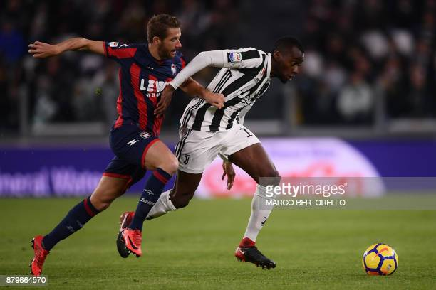 Crotone's midfielder Marcus Christer Rohden of Sweden fights for the ball with Juventus' midfielder Blaise Matuidi from France during the Italian...