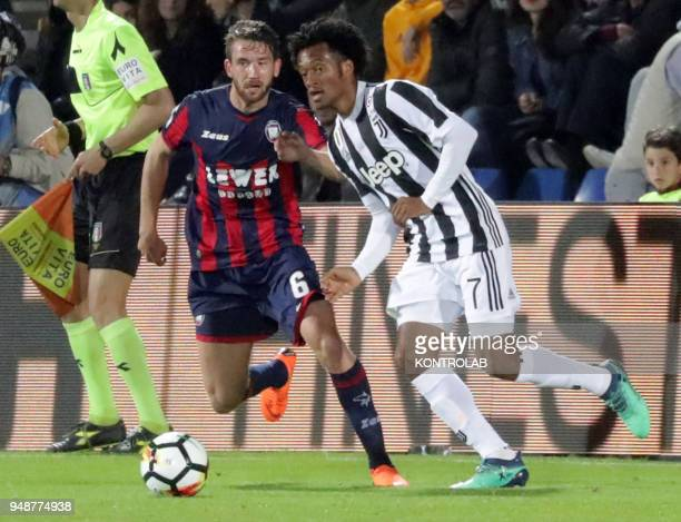STADIUM CROTONE CALABRIA ITALY Crotone's Swedish midfielder Marcus Rohden fights for the ball with Juventus' Colombian striker Juan Cuadrado during...