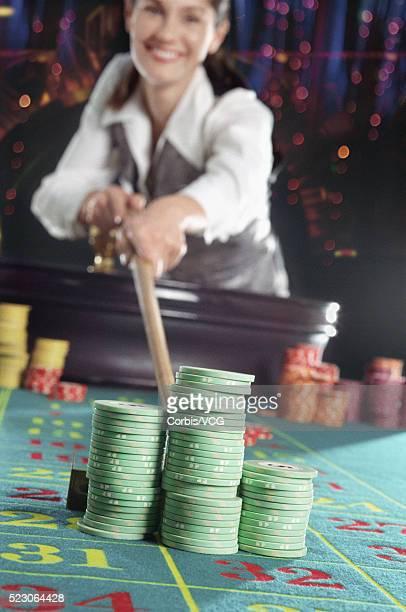 Croupier and gambling chips