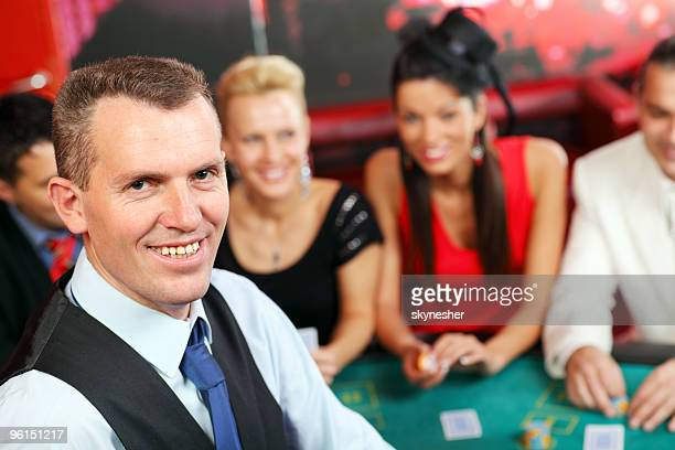 Croupier and players casino.